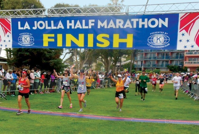 Runners rejoice while reaching the finish line at Ellen Browning Scripps Park during a previous year's La Jolla Half Marathon.