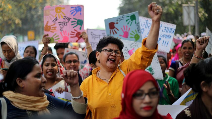 Indian women shout slogans during a march to observe International Women's Day in New Delhi, India,