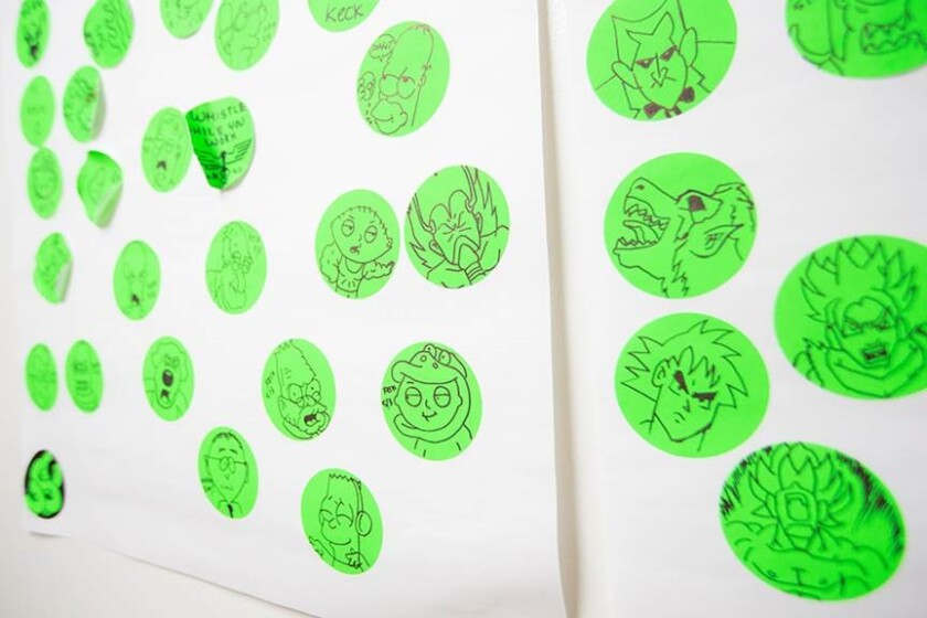 At Keck Hospital of USC, staff tried to provide a little levity by doodling on stickers worn by employees and patients after they had been screened for coronavirus symptoms.