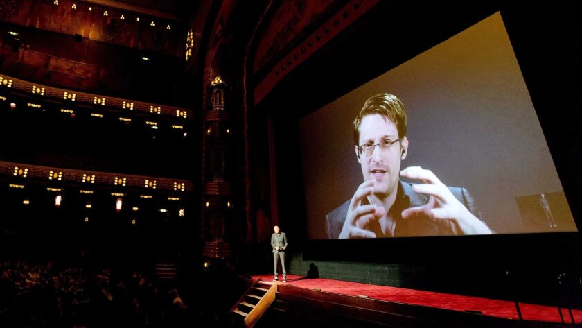 Snowden talks to the audience at the premiere of the movie Snowden in Amsterdam