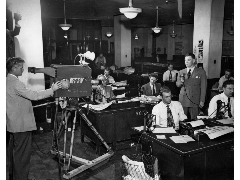 Reporter Bob Hartmann comments on election results to KTTV camera in 1950