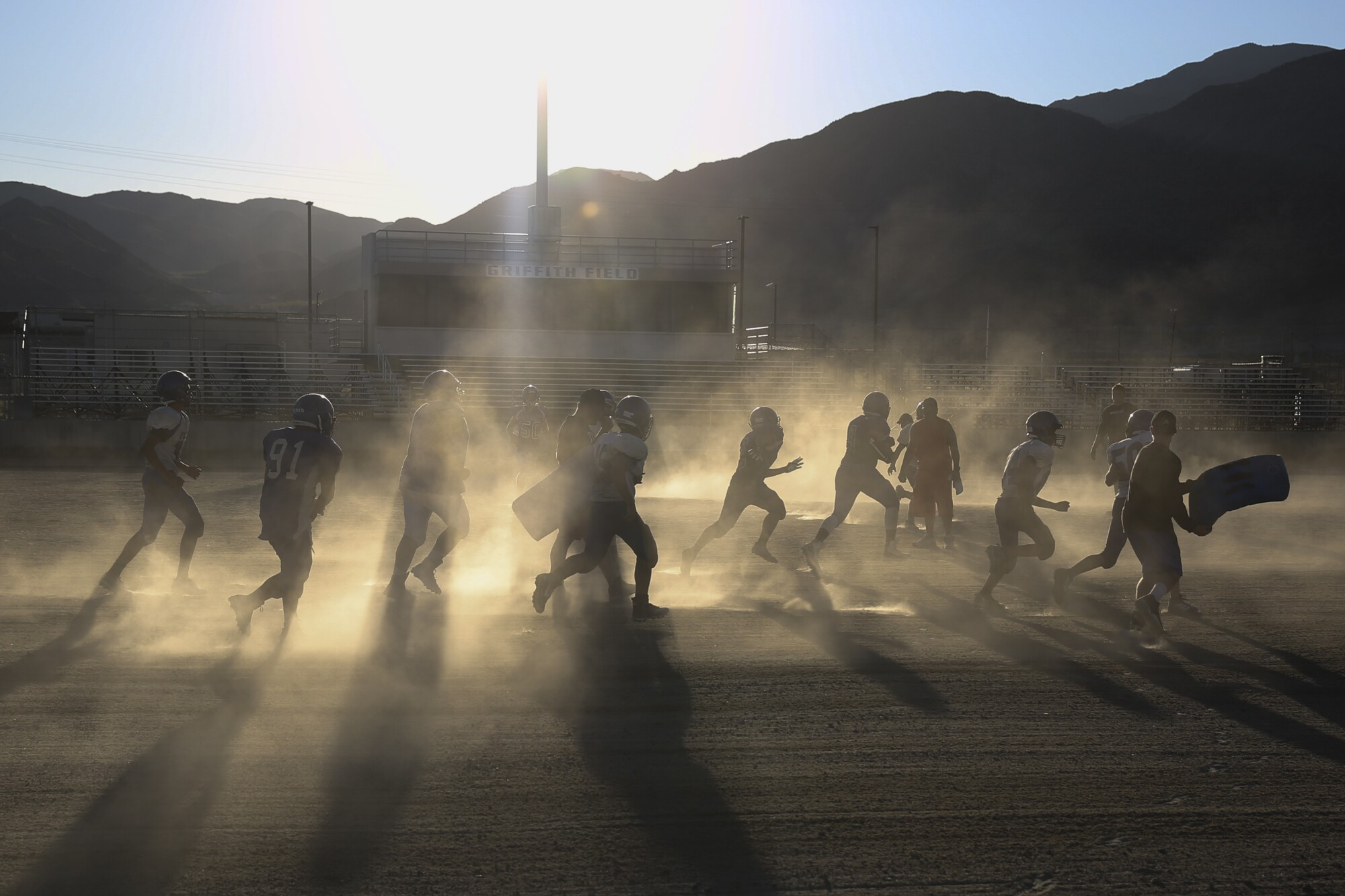 The Trona High football team practices in 108-degree weather on Aug. 14. The Sandmen have always played on a dirt-and-rock field.