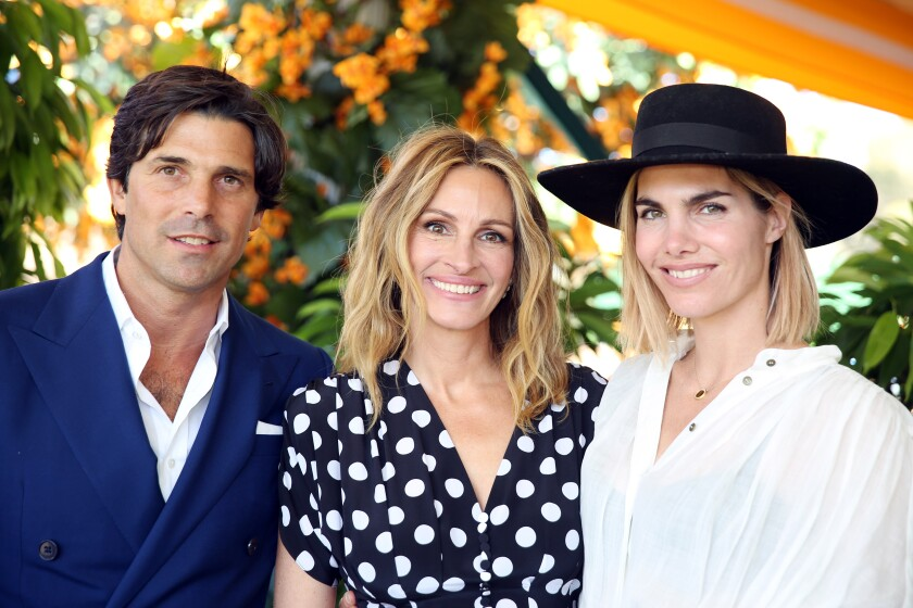 Argentine polo player Nacho Figueras, left, and his wife, Delfina Blaquier, right, also a polo player, join Julia Roberts for the 10th anniversary of the Veuve Clicquot Polo Classic at Will Rogers Park on Saturday.