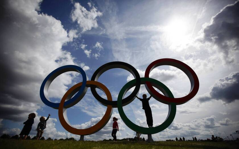Children play on the Olympic rings at the rowing venue in Eton Dorney, near Windsor, England,