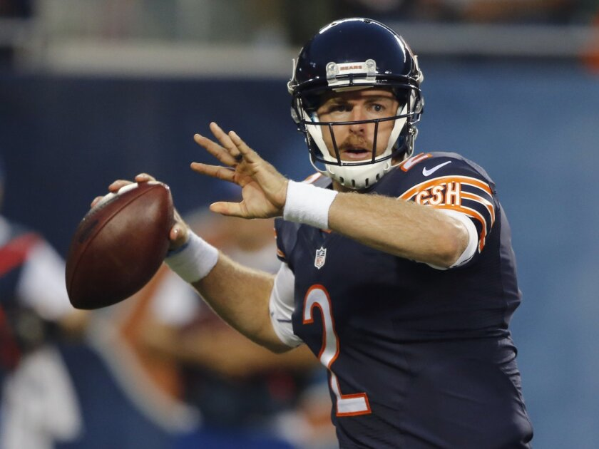 Chicago Bears quarterback Jordan Palmer prepares to throw a pass during the first half of an NFL preseason football game against the Philadelphia Eagles on Friday, Aug. 8, 2014, in Chicago. (AP Photo/Charles Rex Arbogast)