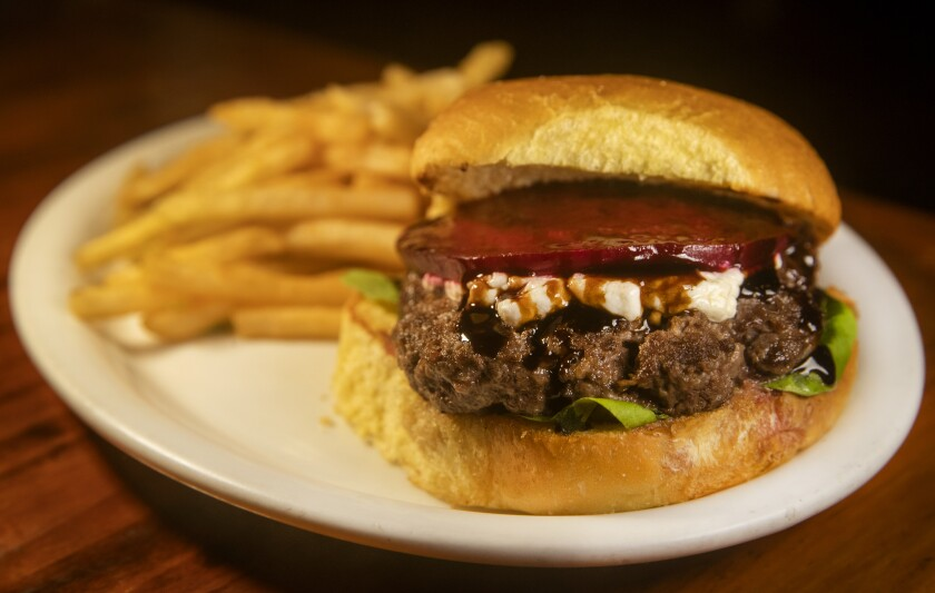 The Hilo Bay burger is served with your choice of french fries, salad, soy beans or cole slaw at the Hilo Burger Joint in Hilo, Hawaii.