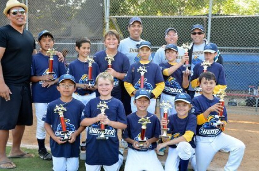 Del Mar Little League AAA Thunder (from left) first row: Michael Hao, Aiden Springer, Joey Stack, Ian Crosbie, Andrew Park. 2nd row: Coach Gary Ladrido, Chase Ladrido, Maximino Romero, Jake Scott, Ryland Means, Conor Sefkow, Derek Rusher. 3rd row: Manager Doug Means, Coach Troy Rusher, Coach Rob Stack.