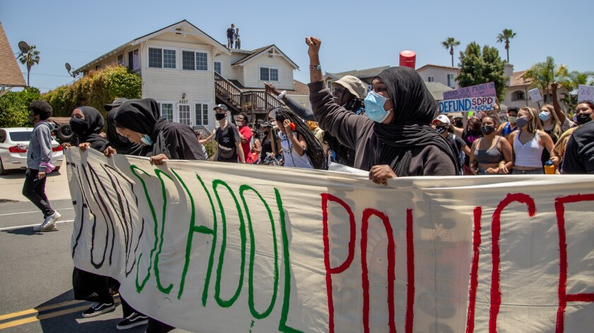 Protestors in support of defunding school police march through University Heights on July 2, 2020.