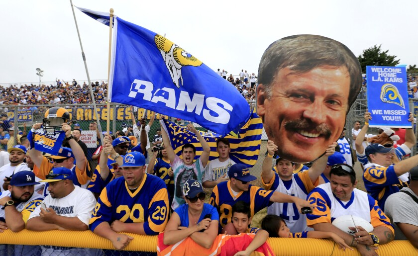 Tom Bateman, with his Stan Kroenke image in tow, joins other Rams fans in Oxnard to watch the team participate in a joint training session with the Dallas Cowboys.