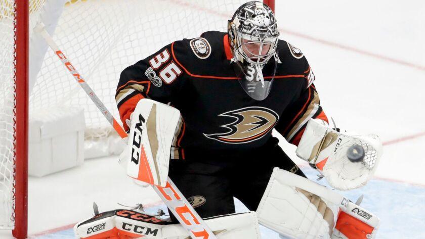 Anaheim Ducks goalie John Gibson blocks a shot as against the Calgary Flames during the third period