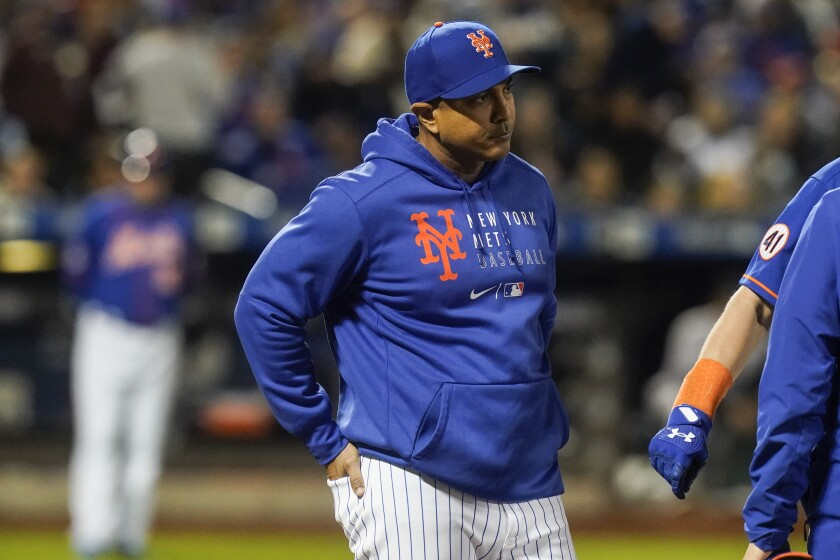 New York Mets manager Luis Rojas checks on Jeff McNeil after he was hit by a pitch during the fourth inning of a baseball game against the Miami Marlins, Thursday, Sept. 30, 2021, in New York. (AP Photo/Frank Franklin II)