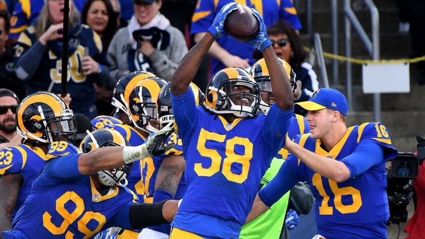 LOS ANGLELES, CA. DECEMBER 30, 2018-Rams linebacker Cory Littleton celebrates a touchdown with teama