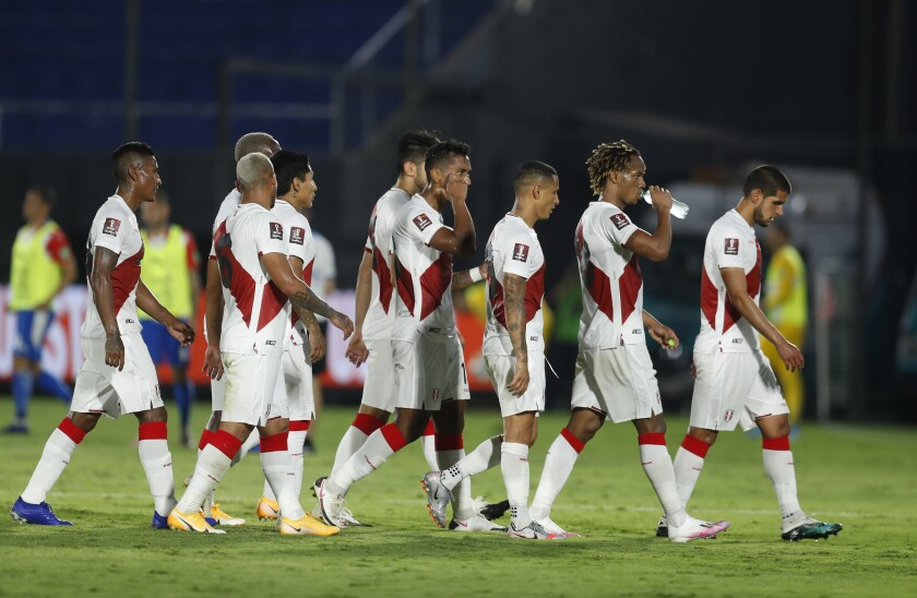 Peru's soccer players leave the field at the end of the first half during a qualifying soccer match for the FIFA World Cup Qatar 2022 against Paraguay at the Defensores del Chaco stadium, in Asuncion, Paraguay, Thursday, Oct.8, 2020. (AP Photo/Jorge Saenz)