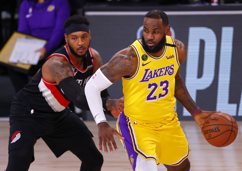 Lakers' LeBron James drives the ball against Portland Trail Blazers' Carmelo Anthony.
