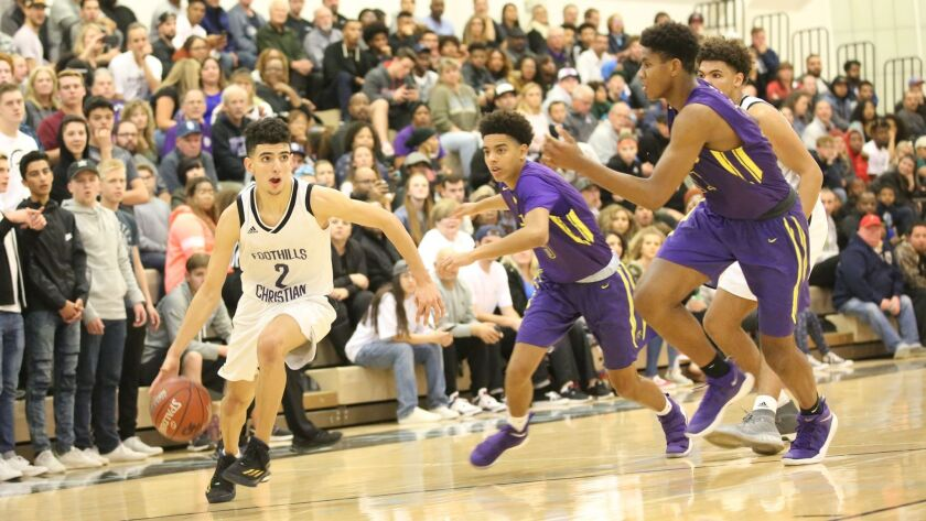 Yassine Gharram brings the ball up the court for Foothills Christian in the quarterfinals.