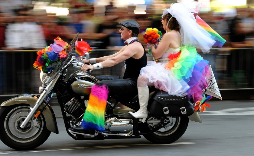 It would have been fun to see Catholic League President Bill Donohue march in a parade like this. Here, on June 30, 2013, a couple celebrates same-sex marriage in San Francisco's Market Street in that city's annual Gay Pride parade.