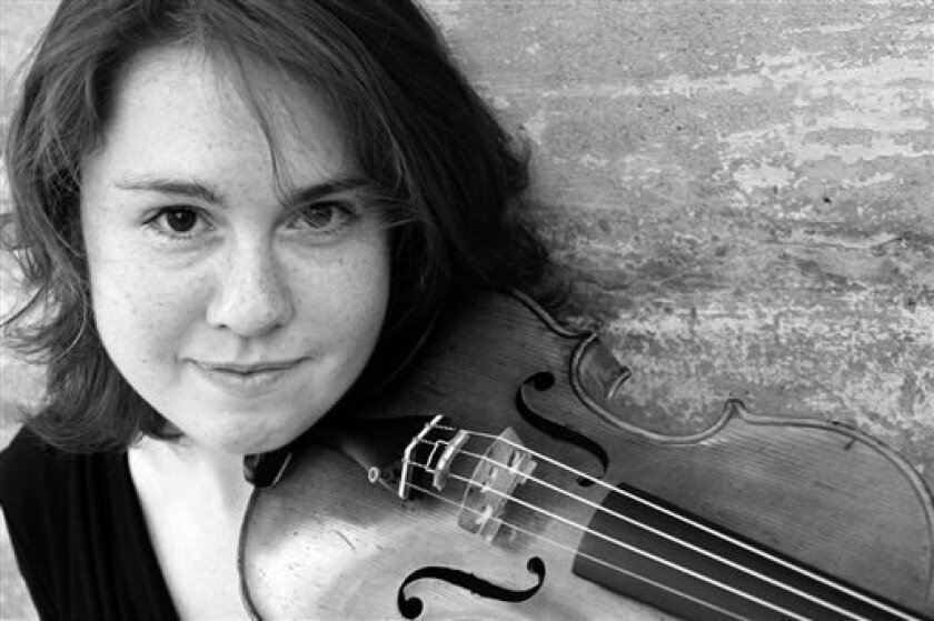 """This undated photo provided by the Pulitzer Prize Board shows violinist Caroline Shaw, who was awarded the 2013 Pulitzer Prize for Music for her work """"Partita for 8 Voices"""", on Monday, April 15, 2013. (AP Photo/Pulitzer Prize Board)"""