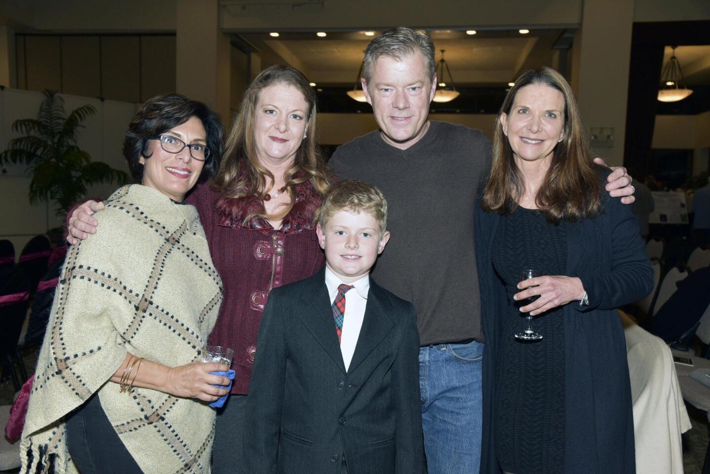 Board member Roberta Arzola, Kari and John Carley with Matthew, board member Jill Stiker