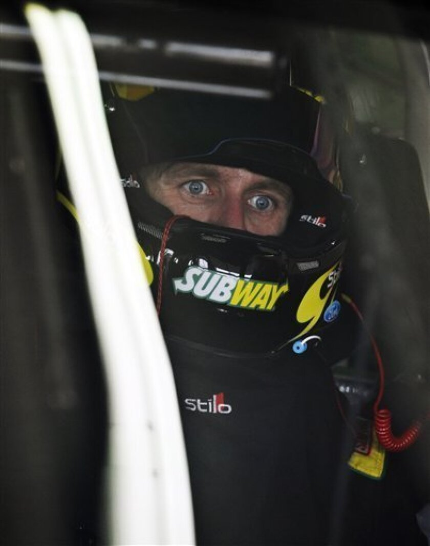 Carl Edwards sits in his car during practice for Sunday's NASCAR Sprint Cup Series auto race at Atlanta Motor Speedway, Friday, Aug. 31, 2012, in Hampton, Ga. (AP Photo/Rainier Ehrhardt)