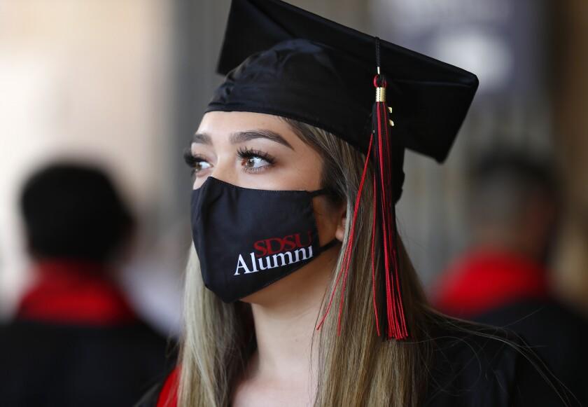 Amber Ramirez wears a SDSU mask as she gets ready go graduate.