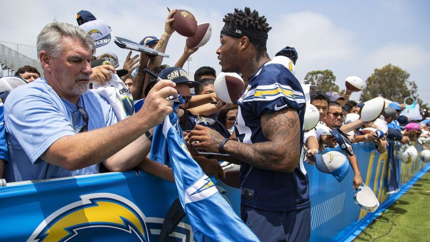 Rookie safety Derwin James meets with Chargers fans after training camp practice in Costa Mesa.
