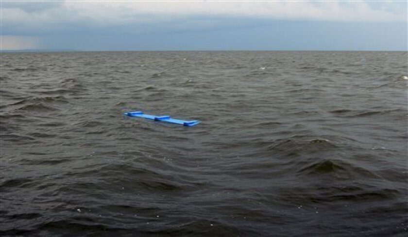 In this photo provided by Russia Emergency Situations Ministry press service, Sunday July 10, 2011, showing debris from a tourist boat that sank on the Volga River, in central Russia on Sunday, with 180 people aboard. One person is reported to be dead and 15 still missing after the double-decker passenger boat sank in the middle of the river some 3 kilometers (2 miles) away from the nearest bank, in the Tatarstan region, about 450 miles (750 kilometers) east of Moscow, according to Regional emergencies ministry spokesman Marat Rakhmatullin. (AP Photo/Russian Ministry of Emergency Situations press service)