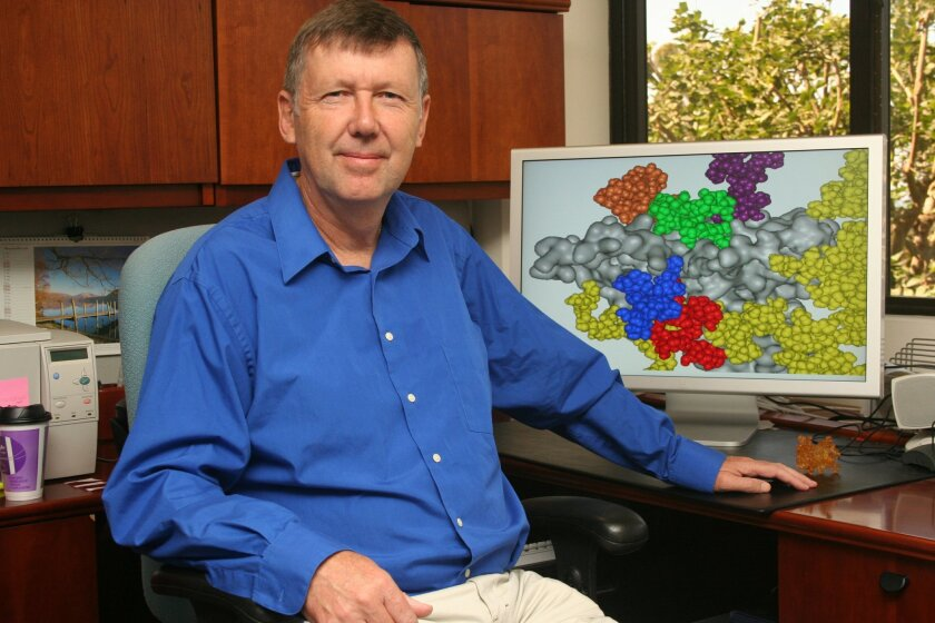 Dennis Burton of The Scripps Research Institute showed a model of HIV related to his team's antibody study. (Scripps)
