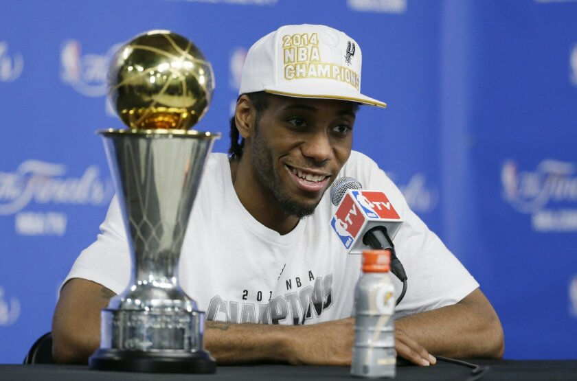 Most Valuable Player San Antonio Spurs forward Kawhi Leonard listens to a question at a news conference after  Game 5 of the NBA basketball finals against the Miami Heat on Sunday, June 15, 2014, in San Antonio. (AP Photo/Tony Gutierrez)