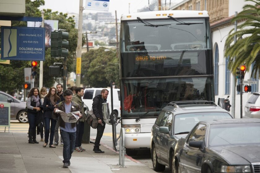 Google employees board a bus in San Francisco bound for the company's Mountain View, Calif., campus.