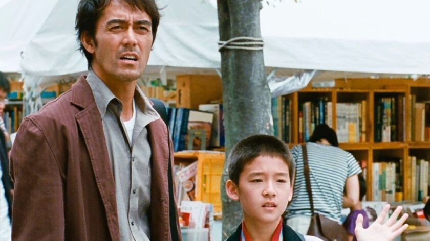 "Hiroshi Abe, left, in the film ""After the Storm."""