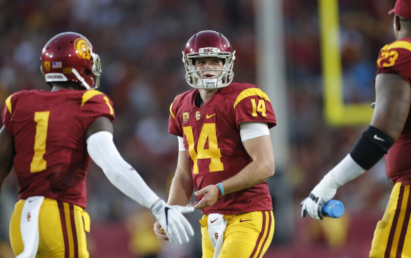 USC quarterback Sam Darnold (14) and receiver Darreus Rogers (1) smile after leading the Trojans to a commanding lead over Arizona State on Oct. 1.