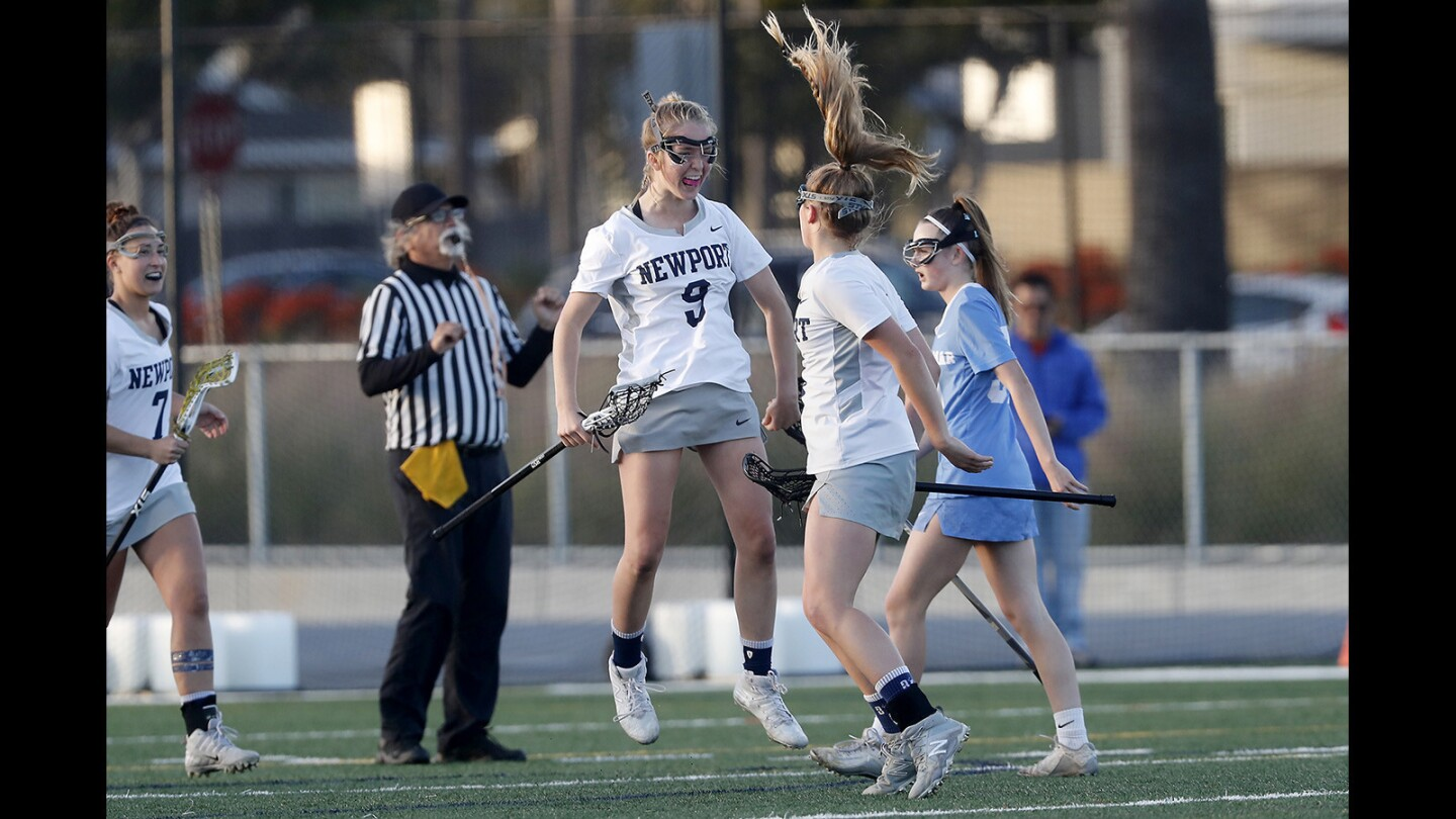 Newport Harbor High's Reese Vickers, center, and Joelle Rothbard, right, celebrate after Vickers assisted on Rothbard's goal during the first half against Corona del Mar in a Sunset League game at Newport Harbor on Thursday.