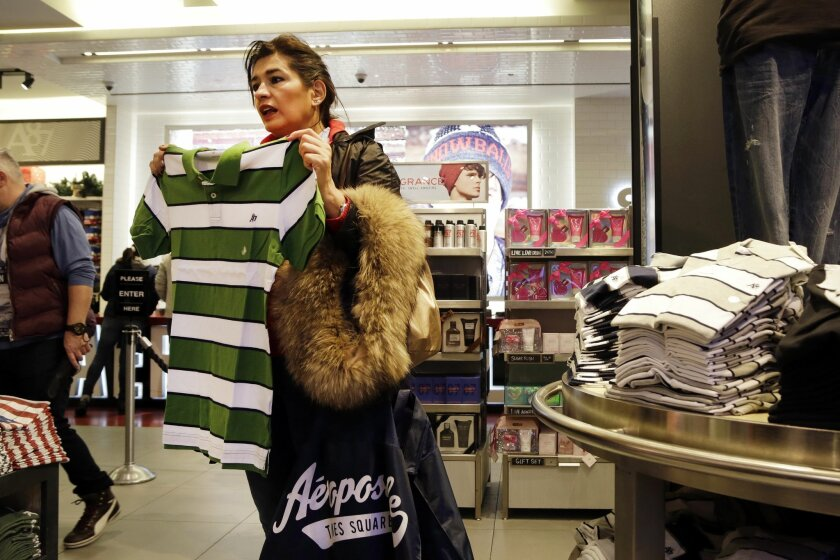 In this Wednesday, Dec. 2, 2015, photo, a woman shops in an Aeropostale clothing store, in New York. The Labor Department reports on consumer prices for December, on Wednesday, Jan. 20, 2016. (AP Photo/Mark Lennihan)