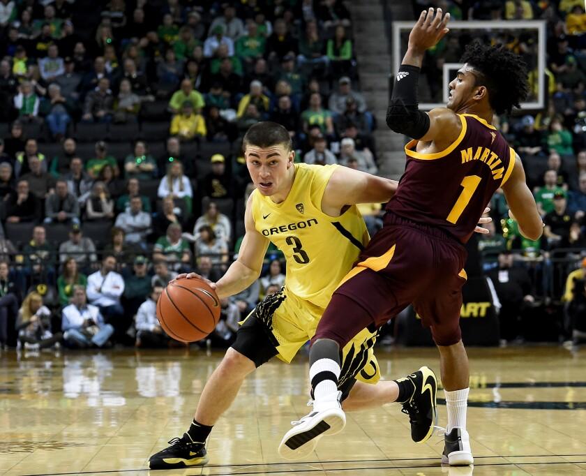 Oregon's Payton Pritchard drives against Arizona State's Remy Martin on Saturday night.
