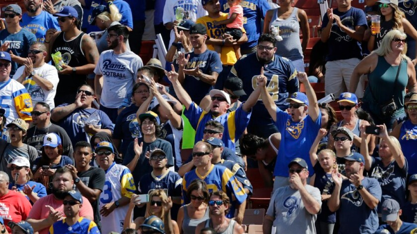 Rams fans cheer during the team's scrimmage at the Coliseum on Aug. 6.