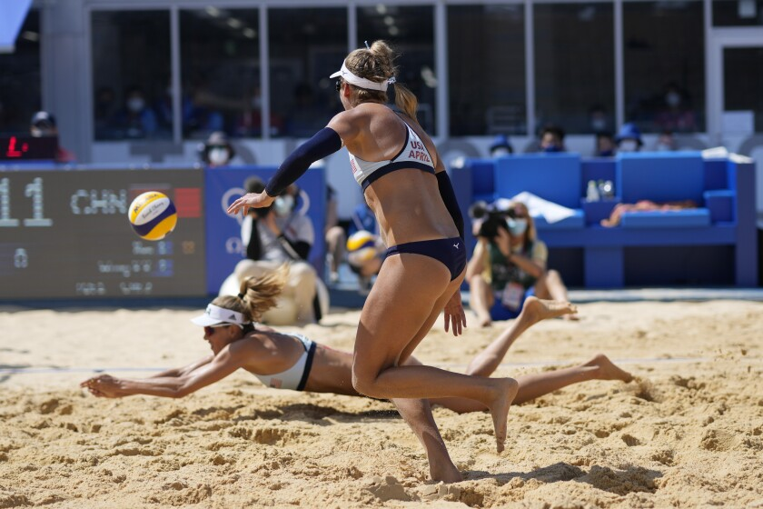 Alix Klineman of the United States, left, and teammate April Ross compete at the Tokyo Olympics Games.