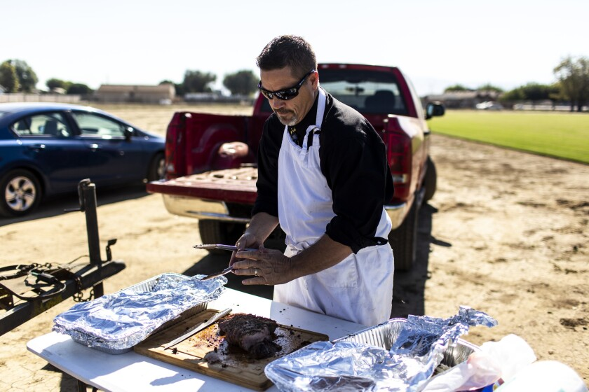TRACY, CALIF. - OCTOBER 24: New Jerusalem district superintendent David Thoming cuts up roasted tri-