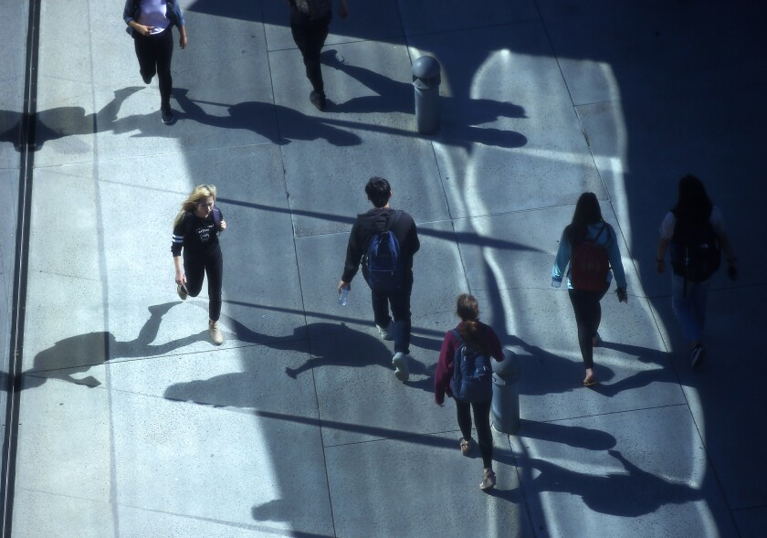 UC San Diego students walk to Geisel Library at the school on April 24, 2019.