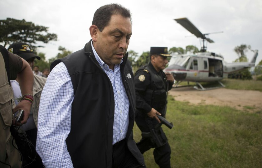 FILE - In this Sept. 20, 2014 file photo, Guatemalan Interior Minister Mauricio Lopez Bonilla arrives to Pajoques, Guatemala after clashes related to the building of a factory. Bonilla, a former army lieutenant colonel who has been head of the Interior Ministry since the current government began in 2012, is stepping down on Thursday, May 21, 2015 amid a growing political crisis and calls for President Otto Perez Molina and officials close to him to resign. (AP Photo/Moises Castillo, File)