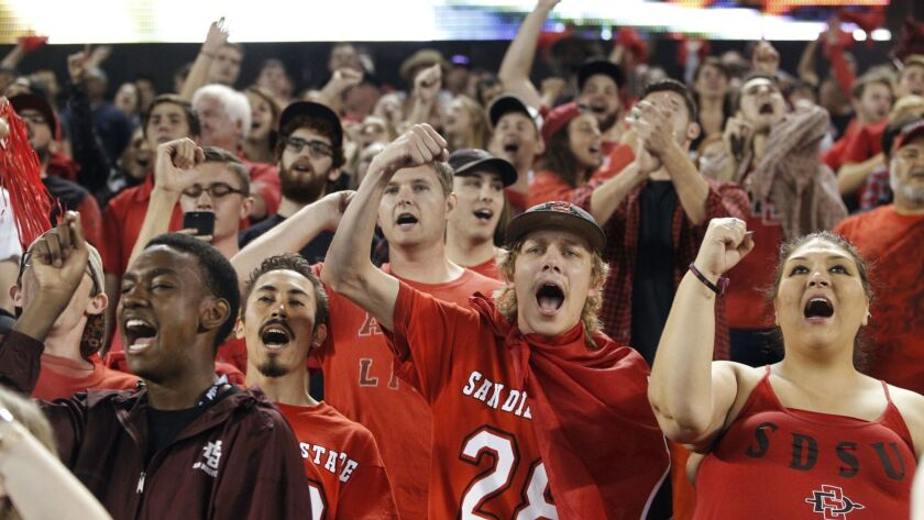 SAN DIEGO, October 14, 2017 | Aztecs fans, including Molly Lange, right, and Tom Lange, second from