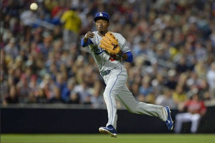 Dee Gordon makes a throw while playing shortstop for the Dodgers in May.