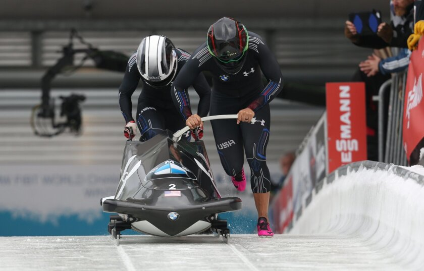 Elana Meyers Taylor, right, and Cherrelle Garrett of the US start during the women's bob competition at the bob and skeleton World Championships in Winterberg, Germany, Thursday, Feb. 26, 2015. (AP Photo/dpa, Ina Fassbender)