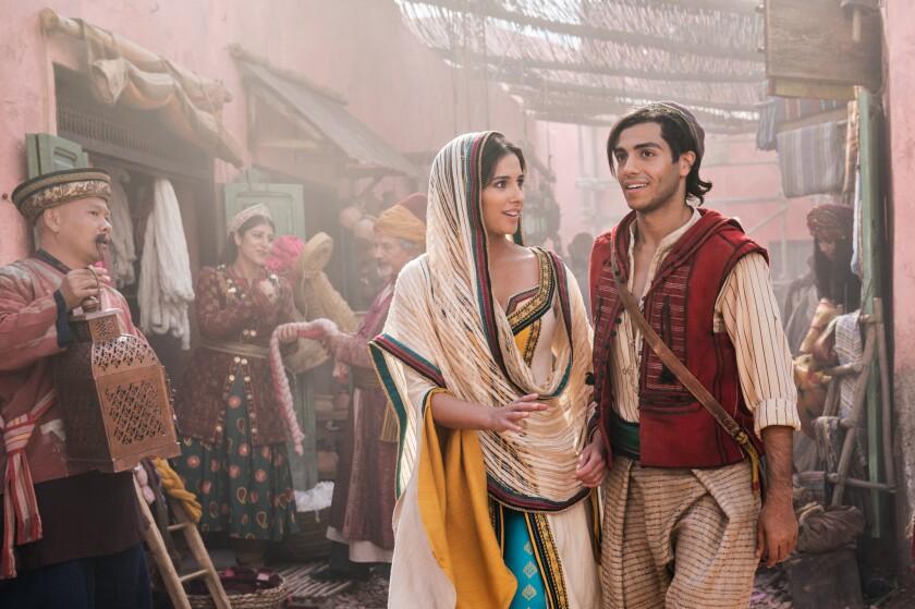 Naomi Scott as Jasmine, left, and Mena Massoud as Aladdin in the Disney film.