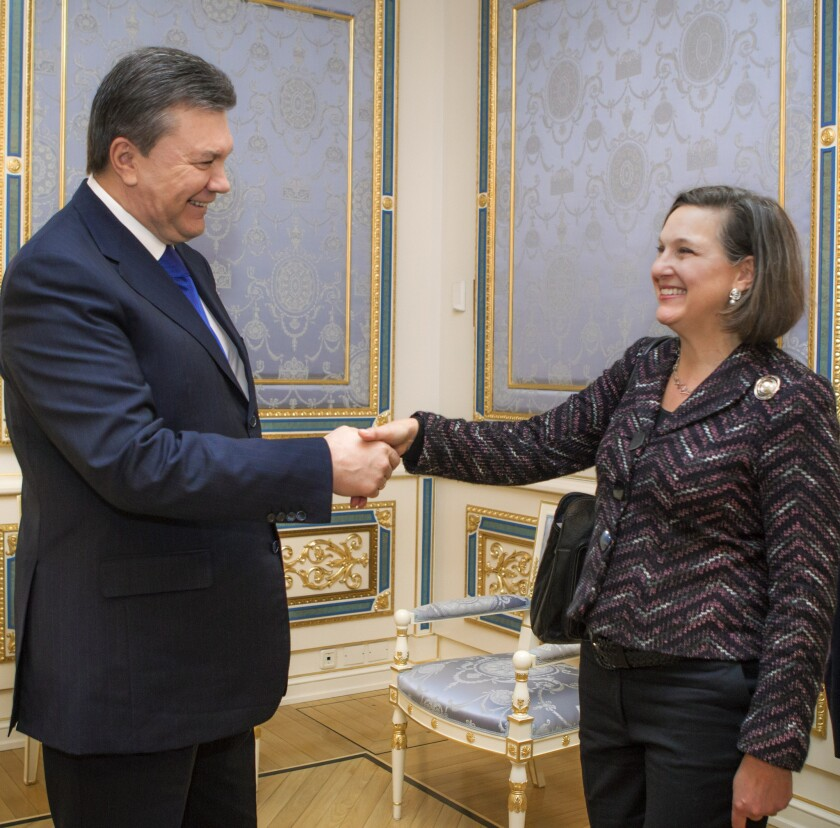 Ukrainian President Viktor Yanukovich greets U.S. Assistant Secretary of State Victoria Nuland in Kiev, the capital. Nuland is believed to be the speaker in a recording that was leaked.