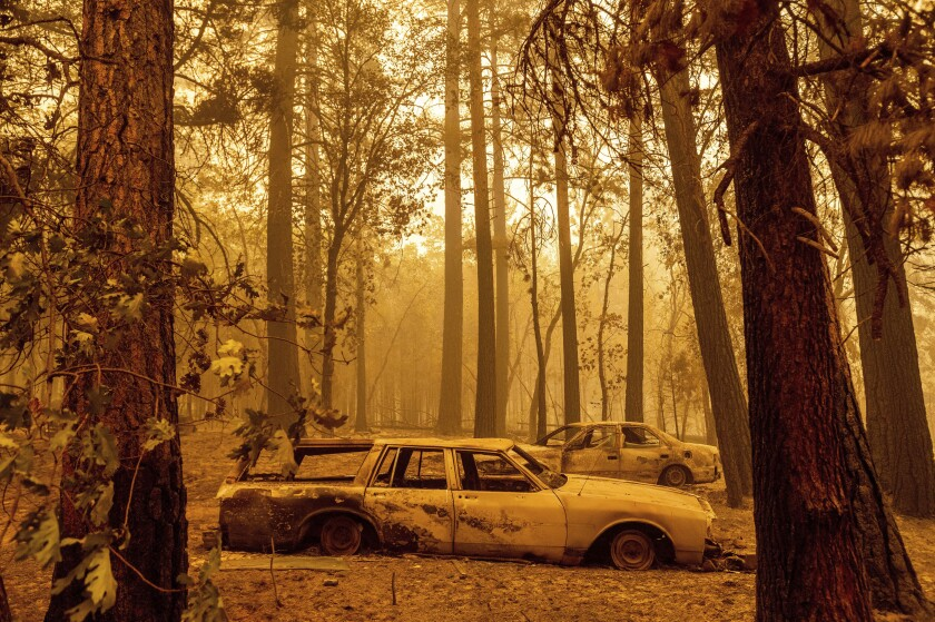 Scorched cars are left behind after the Dixie fire blazed through of Plumas County