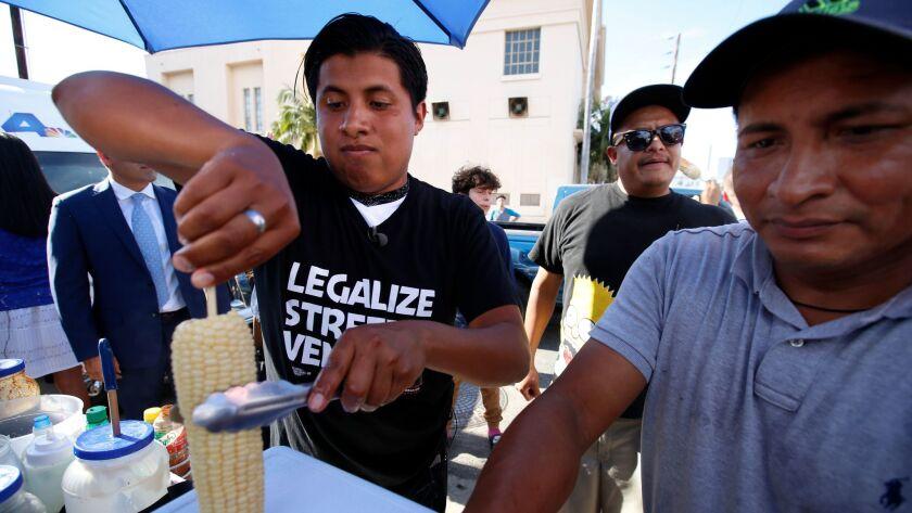 HOLLYWOOD, CA JULY 27, 2017: Benjamin Ramirez, left, with his father Alex Ramirez, right, servin