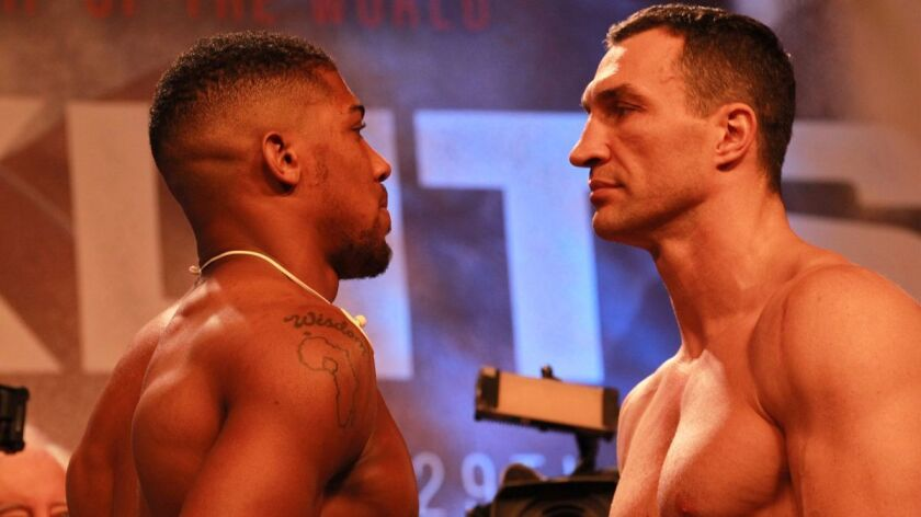 Anthony Joshua, left, and Wladimir Klitschko during the weigh-in Friday for their IBF and WBA title bout at Wembley Stadium in London.