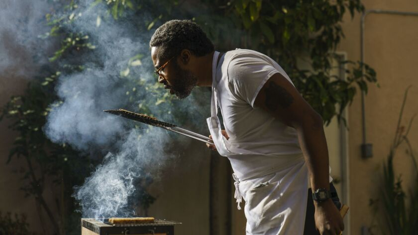 LOS ANGELES, CALIF. -- SATURDAY, MARCH 9, 2019: Ray Anthony Barrett prepares ingredients in Los Ange