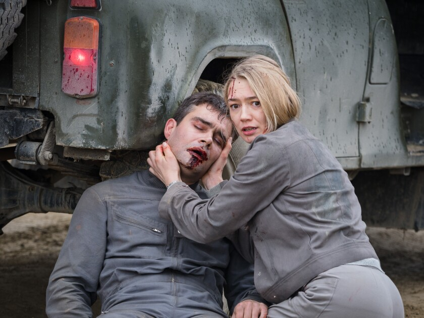 "Pyotr Fyodorov and Oksana Akinshina in the movie ""Sputnik."""