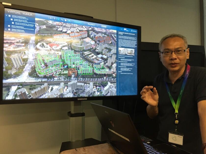Ronnie Lee, deputy director of Singapore's Geospatial Specialist Office, demonstrates Virtual Singap